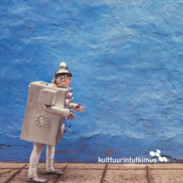 Lehden kansi, jossa robotiksi pukeutunut ihminen